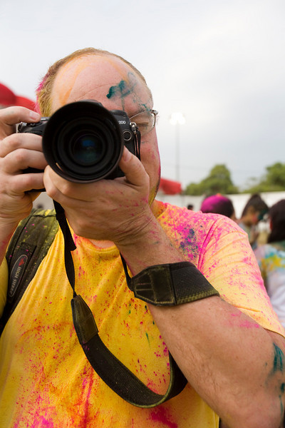 Camera shooting camera in Singapore's Holi Festival