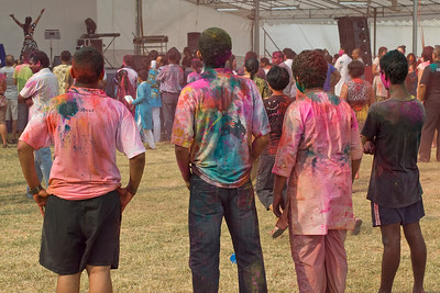 The crowd listening to musical performances at Holi Festival, Singapore