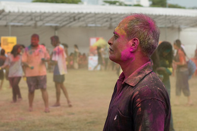 Side profile of a man at Singapore Holi Festival
