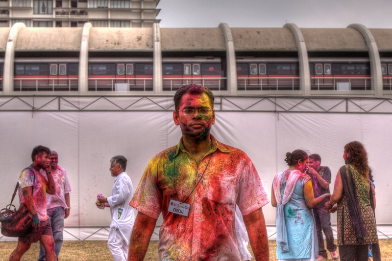 Festival official covered in powdered color in Singapore Holi Festival
