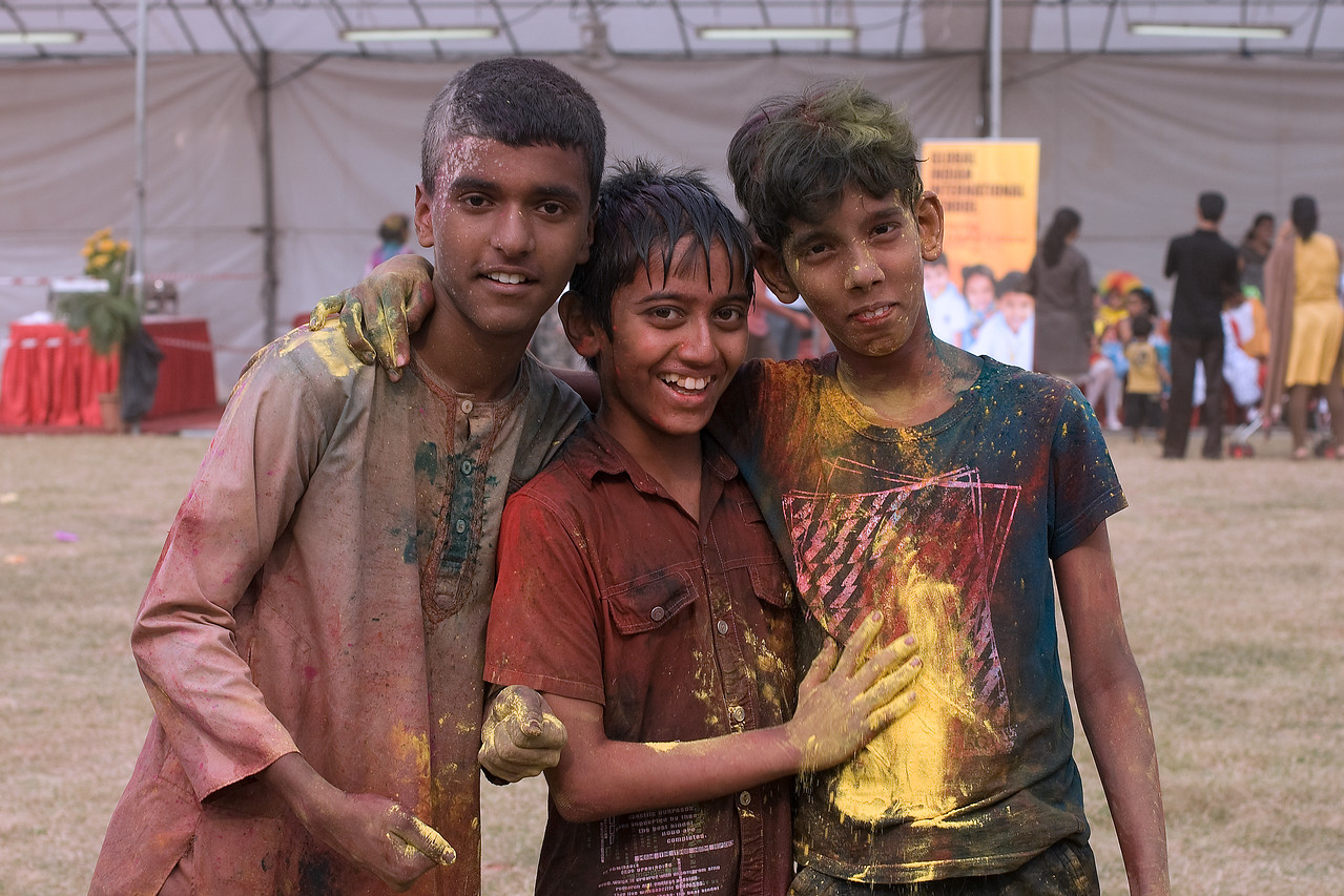 Trio of color-splattered boys at Singapore Holi Festival