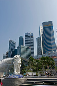 Merlion on the foreground with the skyscrapers as background- Singapore