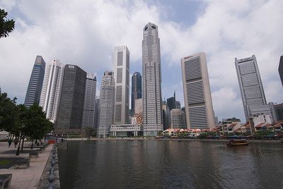 Closer shot of skyscrapers near the river in Singapore