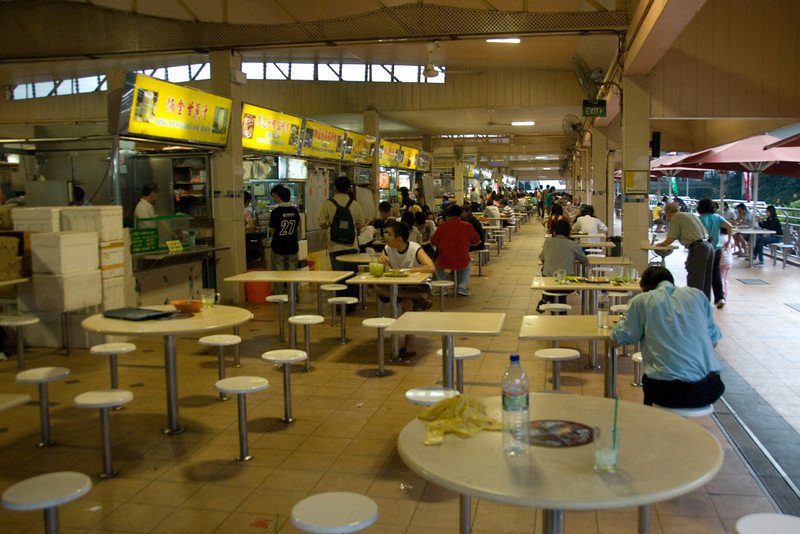 Locals dining at a hawker stand in Singapore