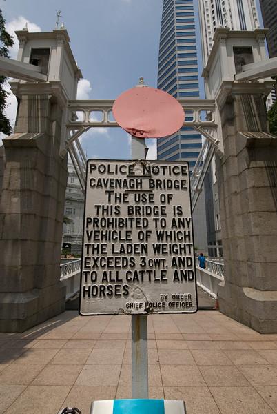 Warning sign at the Cavenagh Bridge - Singapore