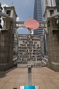 Warning sign at the Cavenagh Bridge - Singapore