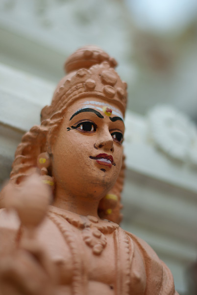 Profile of a Hindu statuette at a pagoda in Singapore