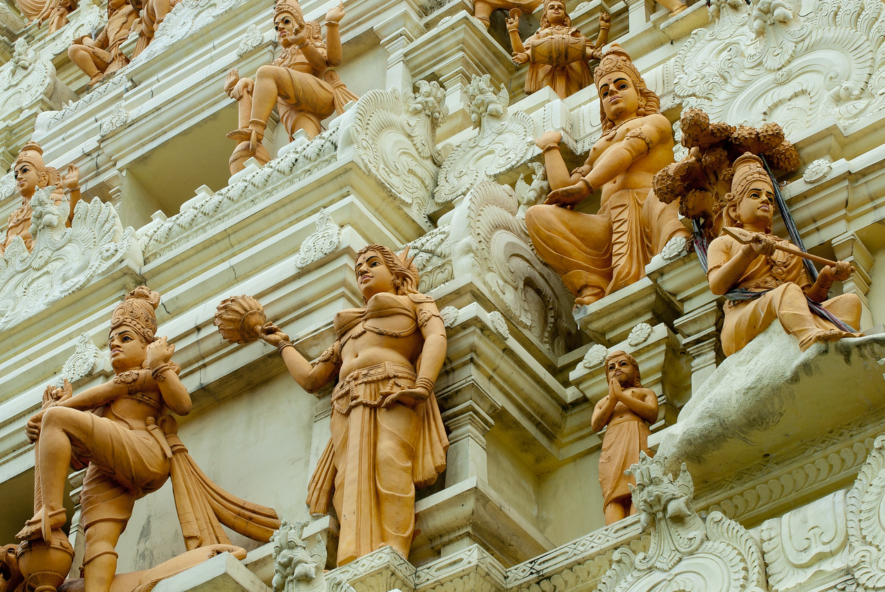 Looking up the display of small Hindu statues in pagoda - Singapore