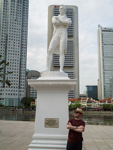 Jonty infront of a statue of Sir Stamford Raffles
