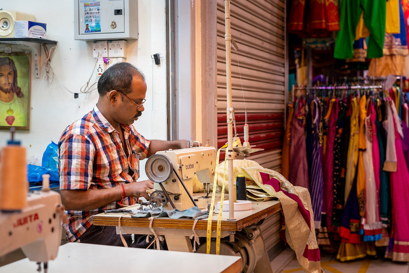 Man working in a tailor shop.