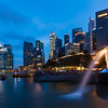Night view of Singapore Merlion at Marina Bay against Singapore skyline