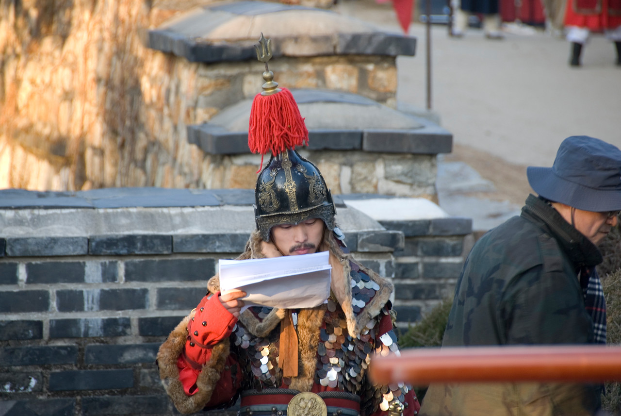 Actor reading the script during filming at Hwaseong Fortress - South Korea