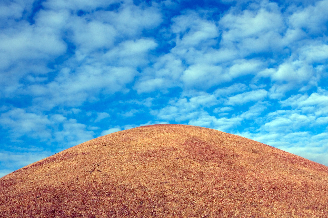 Enhanced photo on top of Burial Mound and clouds - Gyeongju, South Korea