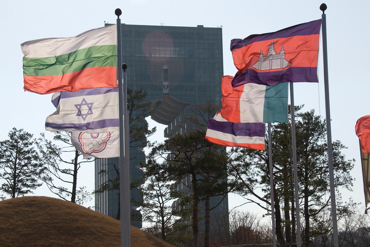 Multi-national flags waving at Korean Cultural Expo Pavillion - Gyeongju, South Korea.