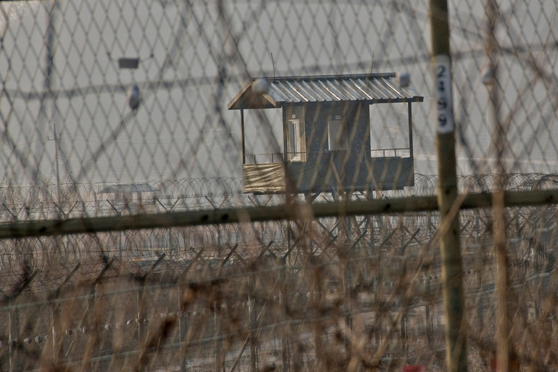 Shot of the guard tower through barb wire - DMZ, South Korea