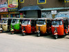 A group of waiting tuk tuks in the Pettah neighborhood of Colombo.
