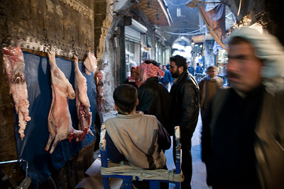 Aleppo, Syria - January, 2008: Meat hanging on the wall in a butcher shop in the Aleppo Souk (bazaar).
