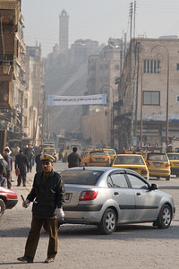 Aleppo, Syria - January, 2008: Busy street leading up to the Citadel in downtwon Aleppo which was first built between 364-333 BC while the majority of the present day structure dates back to Mamluk rule between 1250-1517 AD. (Photo by Christopher Herwig)