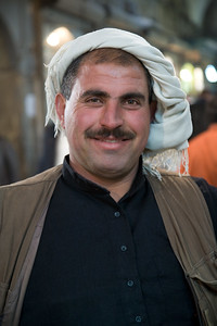 Aleppo, Syria - January, 2008: Portrait of a syrian man in the Aleppo bazaar.