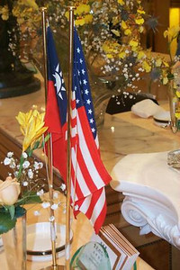USA and Taiwanese flags at a flag holder - Taiwan