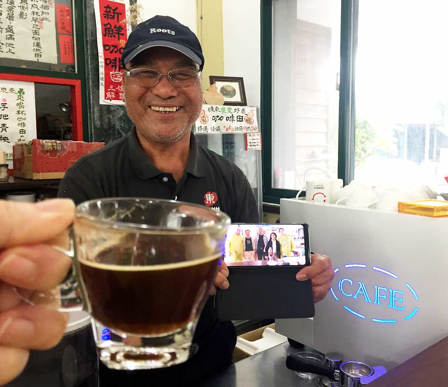 """Our new friend in this East Rift Valley cafe is known as """"Coffee Uncle"""".  He grows, roasts, and brews these special cups of coffee himself!"""