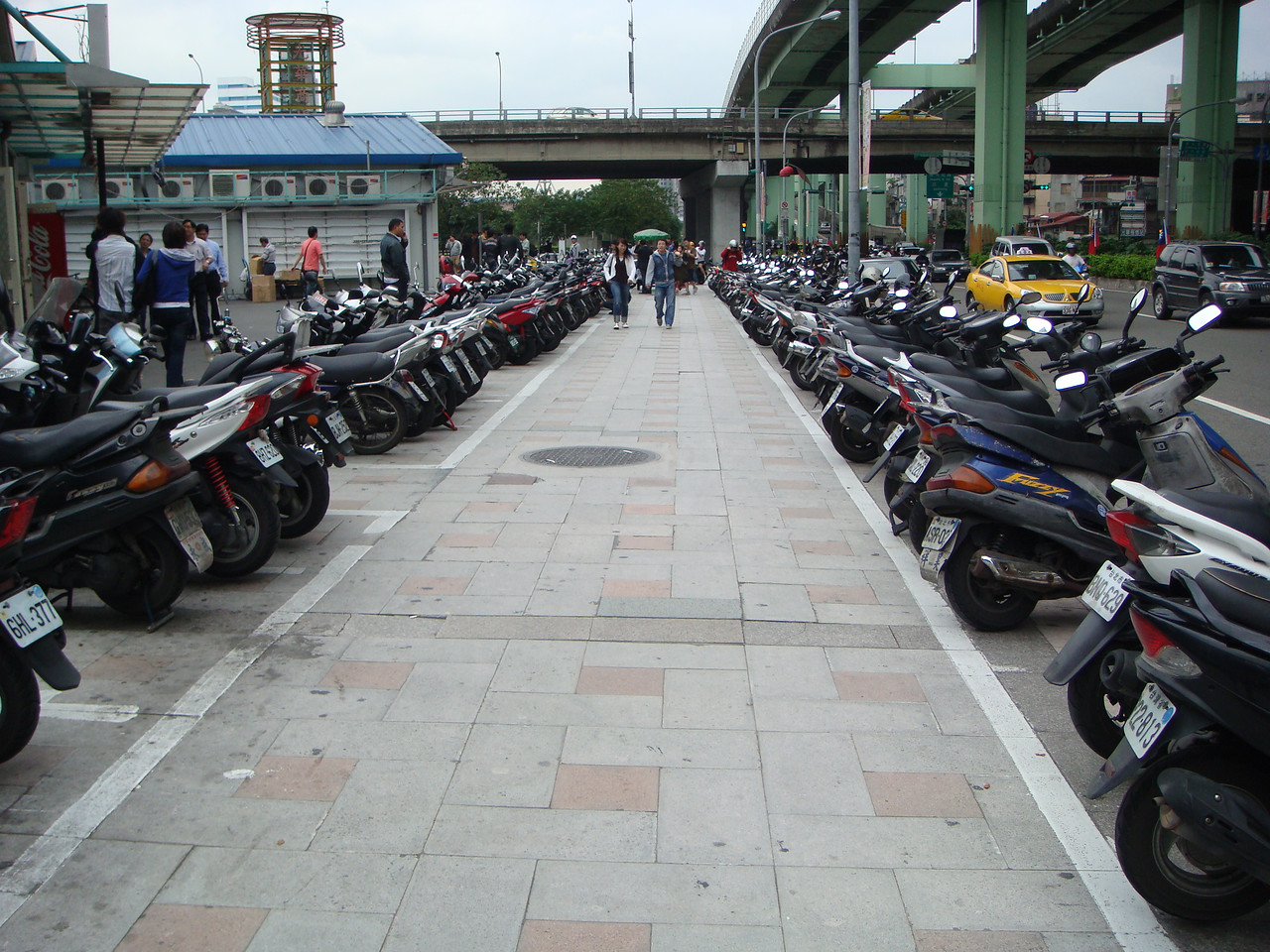 A line of scooters at the street of Taipei, Taiwan