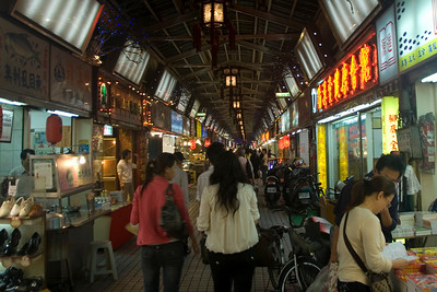 Busy alley at night market near Longshin Temple - Taipei, Taiwan