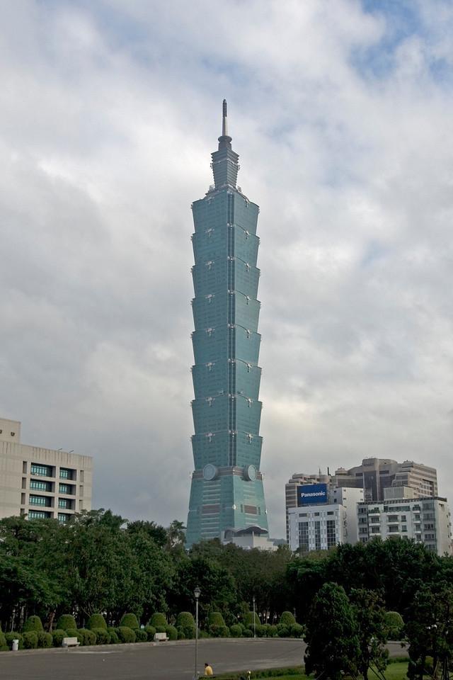 Taipei 101 against clear sky and clouds - Taipei, Taiwan