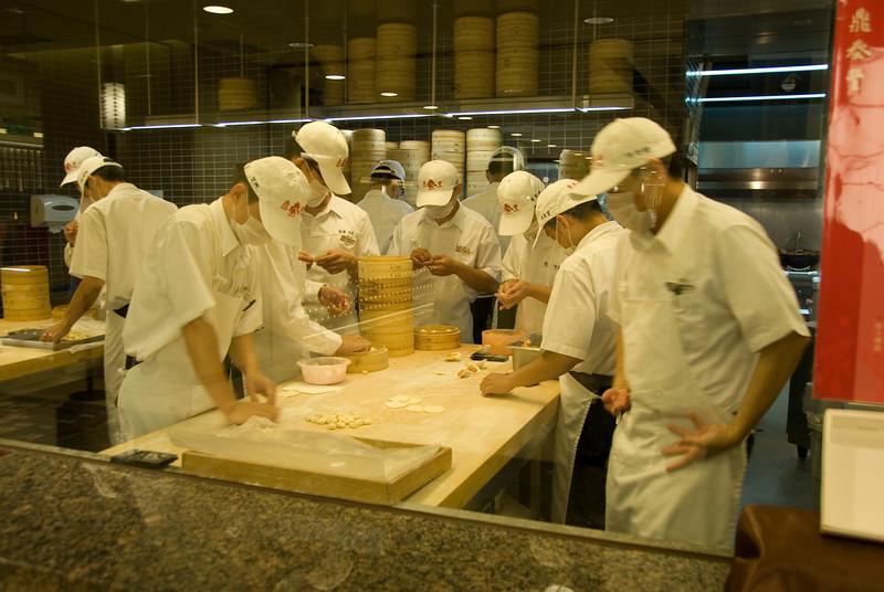 Cooks preparing dumplings at kitchen - Taipei, Taiwan