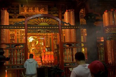Locals worshipping inside Longshan Temple - Taipei, Taiwan