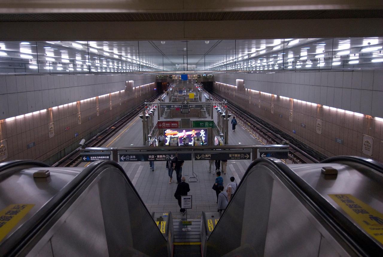Going down the escalator at Taipei Metro - Taipei, Taiwan