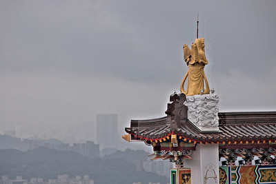 Zhinan Temple Statue with the skyline as backdrop - Taipei, Taiwan