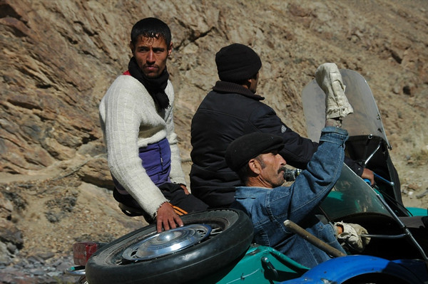 Pamiri Men on Motocycle - Ishkashim, Tajikistan