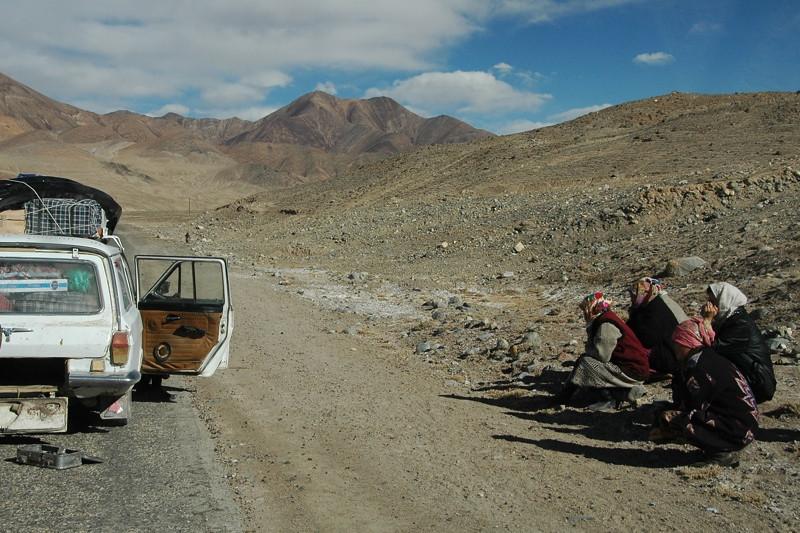 Women Waiting by Broken Down Car - Pamir Mountains, Tajikistan