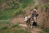 Young Tajik girl transporting water