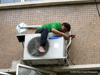 With the amount of air conditioning units in Bangkok, this guy is set for life