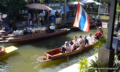 Tourists arrive at the Floating Market