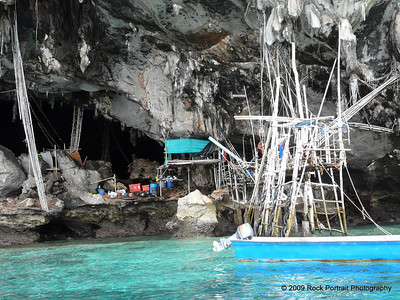 A guy lives in this cave and harvests birds nests amongst other things.  I guess he probably also catches fish and horseshoe crabs.