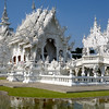 Wat Rong Khun, more well-known among foreigners as the White Temple, is a contemporary unconventional Buddhist temple in Chiang Rai, Thailand. It was designed by Chalermchai Kositpipat in 1997