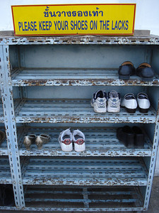 """Wat shoe rack. """"Please Keep Your Shoes On The Lacks"""", Ayuthaya - Thailand."""