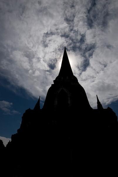 Stupa silhouette against clear sky