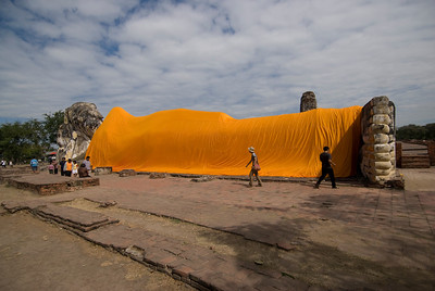 Orange fabric covering the giant reclining Buddha statue - Ayutthaya, Thailand
