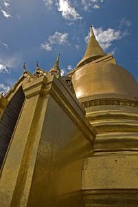 Looking up golden pagoda and stupa Wat Phra Kaew - Bangkok, Thailand
