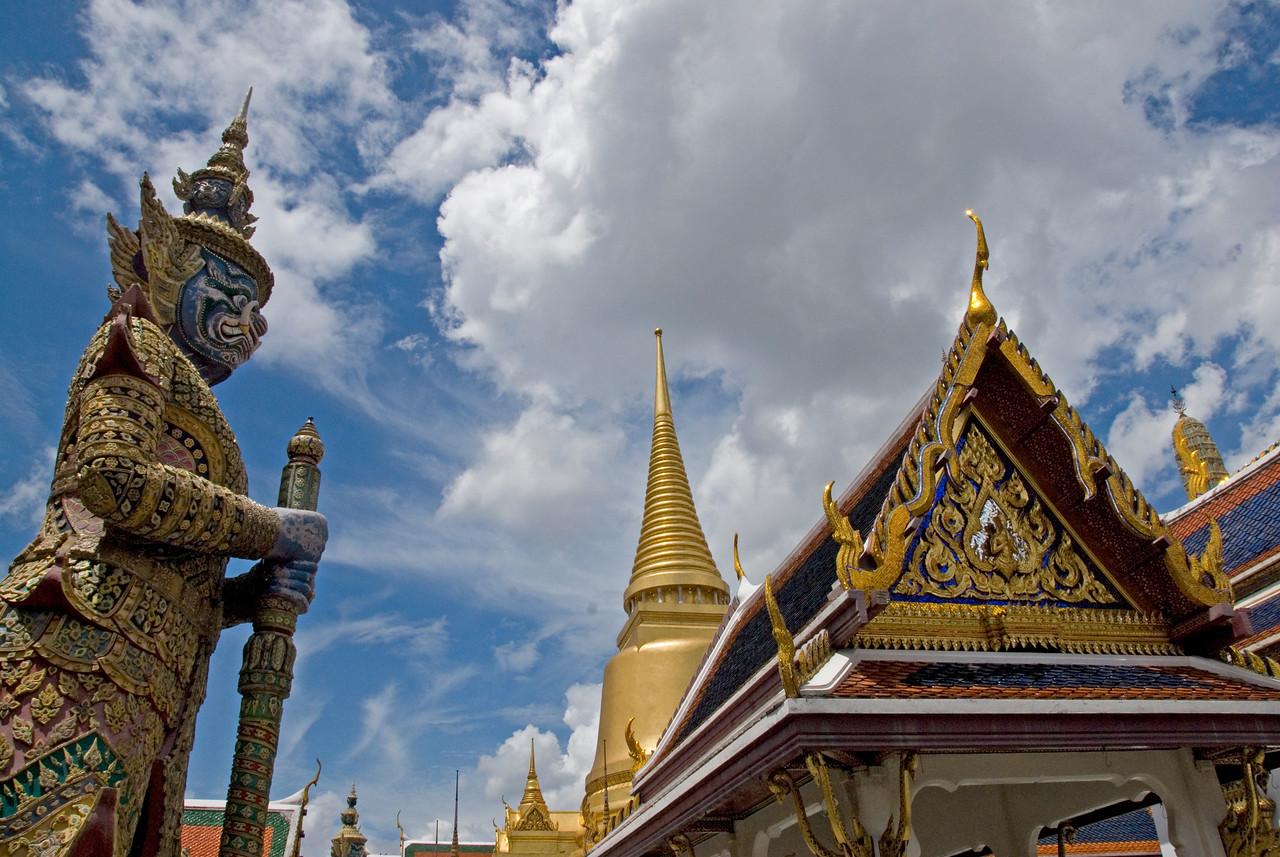 Rooftop and statues inside Wat Phra Kaew - Bangkok, Thailand