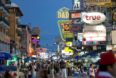 Colorful signs over busy street in Bangkok, Thailand