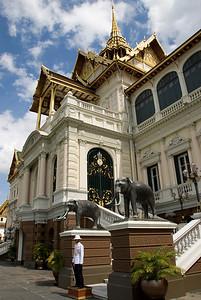 Thai Royal Palace Guard in between two elephant statues - Bangkok, Thailand
