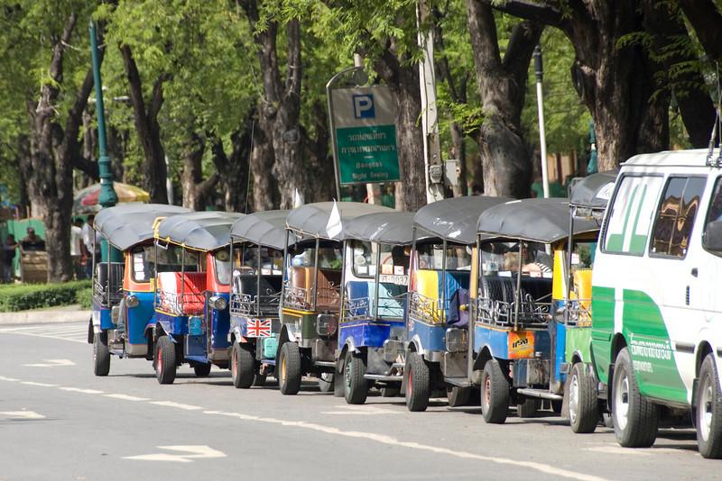 Tuk Tuks parked along side road in Bangkok, Thailand