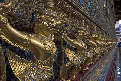 Close-up shot of rows of golden Buddha statues in Wat Phra Kaew - Bangkok, Thailand