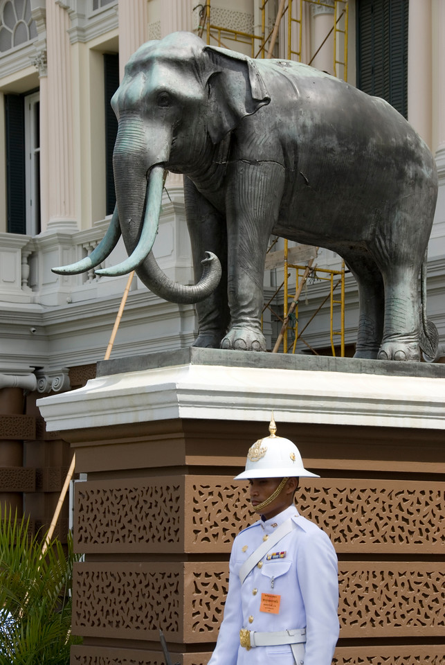 Thai Royal Palace Guard next to elephant statue in Bangkok, Thailand
