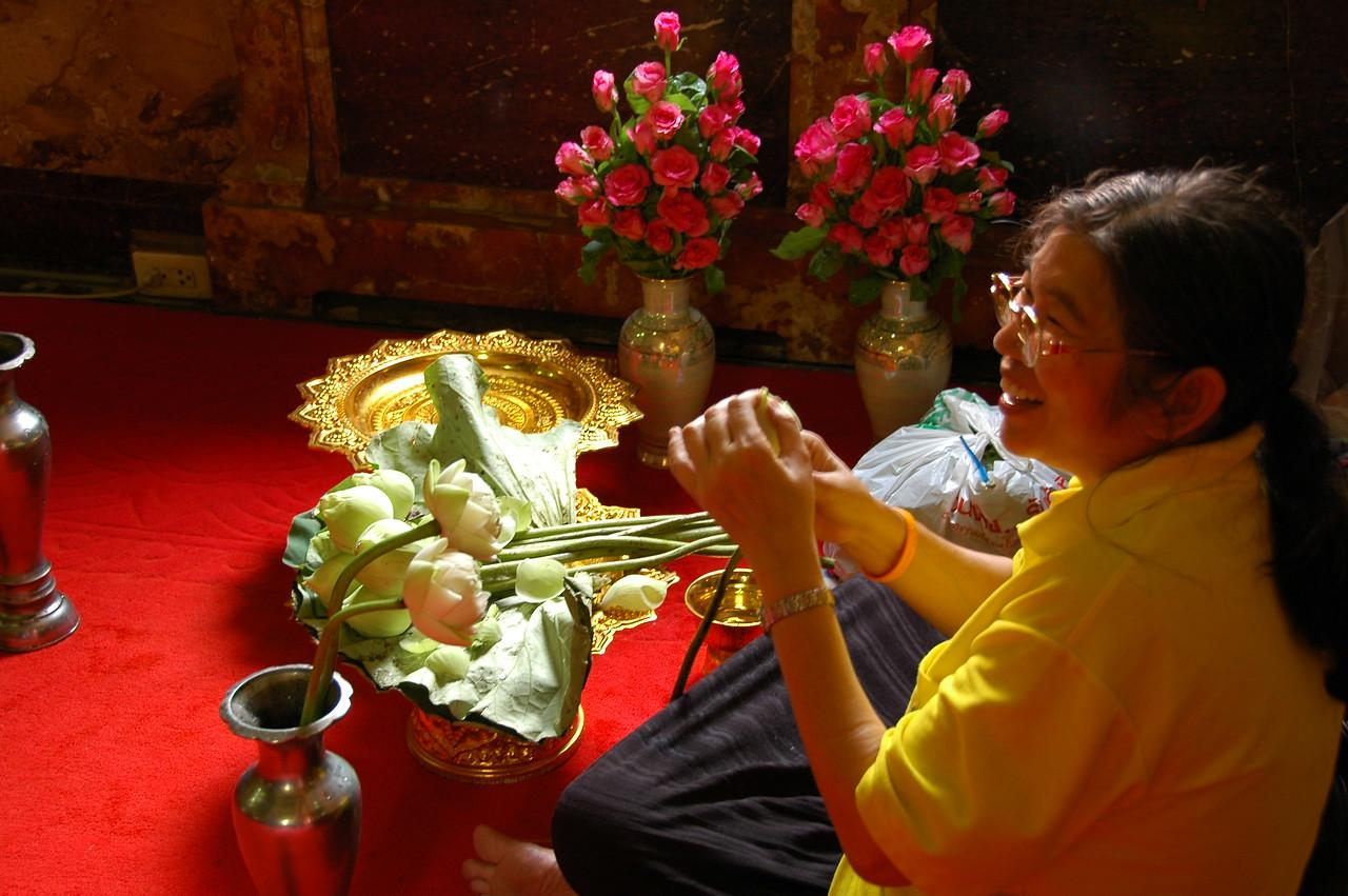 Woman Preparing Lotus Flowers - Bangkok, Thailand